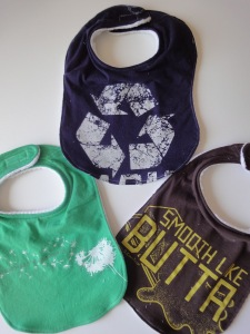 http://betterlifebags.com/2009/01/01/upcycled-shirts-to-baby-bibs/
